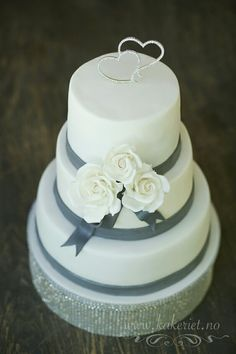 Weddingcake with white roses , bling, and grey. Sophisticated and clean elegance. Made by Kakeriet.no in Sandefjord,  Norway