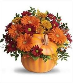 Perfect for a fall centerpiece, birthday or Halloween party, this flower-filled ceramic pumpkin is a real cutie-pie. Bright and light orange gerberas, bronze cu Deco Floral, Arte Floral, Floral Design, Pumpkin Bouquet, Pumpkin Flower, Fall Flowers, Wedding Flowers, Thanksgiving Flowers, Fall Flower Arrangements