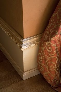 Details!.....wow that is gorgeous, but how much of your base boards actually show, seems like a very expensive detail to cover up, this on a crown molding would be so elegant though
