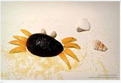 Crab.... Avocado as body, mandarin peel as legs, pistachio as eyes, and couscous as sand.