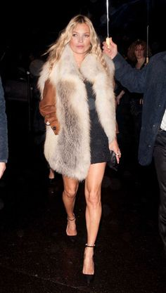 kate moss in amazing fur gilet with black dress bare legs strappy heels