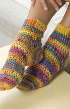 Crochet your own colorful and comfy socks using Red Heart® Heart & Sole® yarn. Intermediate crochet instructions require two skeins of yarn to make one pair of women's size socks. Crochet Socks Pattern, Crochet Boots, Knit Or Crochet, Crochet Clothes, Knitting Patterns, Crochet Patterns, Crochet Sole, Easy Crochet Socks, Crochet Winter