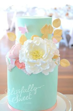 love the colours on this teal, gold pink, lilac wedding cake