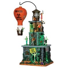 Back Details Add this Lemax Spooky Town Zombie Fortress to your Halloween village or decor today. Balloon rotates around the fortress and Zombies move around the fortress. Volume Control and Power Switch for all functions. Halloween News, Halloween Village, Halloween Art, Halloween Decorations, Halloween Stuff, Halloween Train, Zombies, Village Miniature, Lemax Village