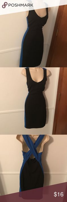 """Jennifer Lopez Black and Blue Dress Beautiful dress only worn once! Black dress with blue back crossing straps and along the sides. Very flattering just don't have any occasion to wear this! Length is 36"""" Comment with any questions Jennifer Lopez Dresses"""
