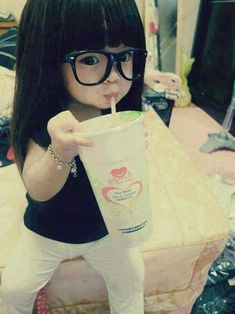 Awww she is too cute! She is so tiny & her glasses & drink are giant :) <3