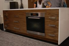 featuring a Miele Oven inside the Bradco Slide N Hide Countertop