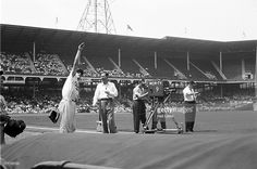 View of Brooklyn Dodgers Pee Wee Reese (1) on field with WOR-TV camera filming 'Knot-Hole Gang' before game vs Philadelphia Phillies at Ebbets Field. Neil Leifer D112423 )