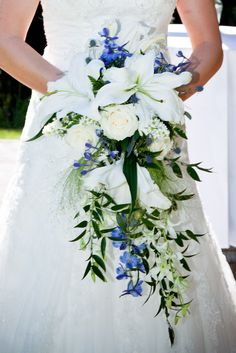 My wedding bouquet: Cascading Bridal Bouquet with lilies, blue delphinium, bells of ireland, roses and laurel by Kathy @ Valley Nursery