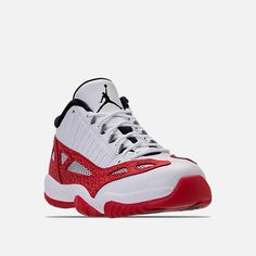 77dbcae57ac9c1 Three Quarter view of Men s Air Jordan 11 Retro Low IE Basketball Shoes in  White