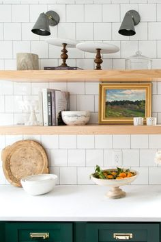Open Shelving Styling. Studio McGee styling. Open Shelving. Wooden shelves. White kitchen. Green cabinets. Cabinet hardware. Bin pulls. Brass pulls. Lacquered brass. Green and brass.