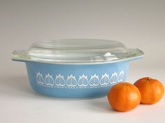 Vintage Pyrex Blue Tulip 043 Oval Casserole with Lid - 1960s Promotional Pyrex Casserole - 1 1/2 Quart Oval Casserole White Flowers on Blue by EightMileVintage on Etsy