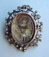 Victorian mourning jewelry with loved one's hair inside.