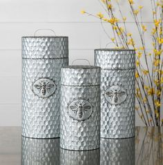 This set of three canisters is made of galvanized metal embossed with a honeycomb pattern with iconic Honeybee emblems as the focal point of each container. Part of our Trisha Yearwood Honeybee Collection.