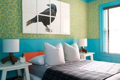 The guest bedroom is brightly colored, with a custom-made wallpaper handprinted by Adelphi Paper Hangings.