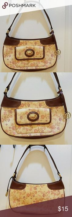 Etienne Aigner Floral Straw Purse Nice 3 compartment purse, 2 open compartments and one miiddle compartment  for cell phone, credit cards, and other stuff. One pouch on the outside. Very nice summer handbag. Nice floral colors. Measures 12 inches long,  7 inches high, and 3 inches wide.  Strap is  9 inches.   Great condition  and smoke free home. Etienne Aigner Bags Shoulder Bags