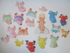 Mattel 1970s The Sunshine Family, Baby Doll, Clothing, Baby 'Sweets'.  Had/have this paperdoll family.  Still have most of the pieces.  This was my favourite as a kid
