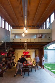 Carterwilliamson Architects transformed a cowshed into a modern house with plenty of original character. The Cowshed House was a simple structure  on a small plot of land with roads on three sides, positioned so that a north-facing courtyard essentially expanded the interior. Glebe, Sydney, Australia