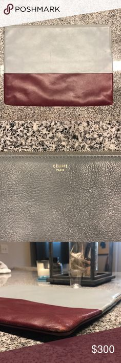 Celine Solo Pouch Clutch Bag A pre-owned gently used Celine clutch zipper pouch. It is oversized and fits a lot.  It is a two toned pouch that is grey and burgundy. The pouch was sold in stores approximately in 2013. It's has some minor wear on the bottoms and the stitching is slightly loosened on the middle of the two sides. The clutch is still in great condition. The inside is clean and has the date code stamped inside.  The hardware is in mint condition with the Celine logo on the zipper…