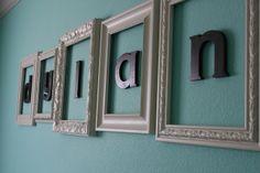 Framed name above crib