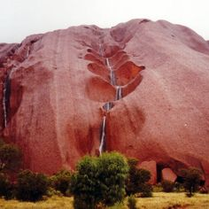 Uluru Waterfalls, Australia. The park covers 1326 square kilometers and includes the features it is named after - Uluru / Ayers Rock and, 40 kilometres to its west, Kata Tjuta / Mount Olga. The location is listed with UNESCO World Heritage sites.