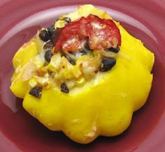 Corn, black beans, and tomato stuffed pattypan squash    3 large pattypan squash  1 Tbsp olive oil  1 onion, diced  3 garlic cloves, minced  1 1/2 cups cooked black beans (or 1 can, drained and rinsed)  2 ears corn, kernels cut off  3 medium tomatoes, chopped  1 Tbsp cumin  1/2 tsp cayenne pepper  salt to taste  1/4 cup shredded mozzarella cheese