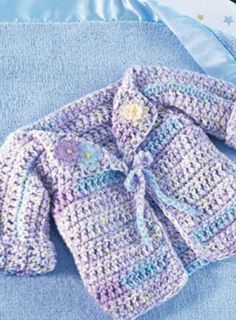 PIN FOR LATER -- Winter is coming, so get a head start on keeping your little one warm with this embellished baby sweater.