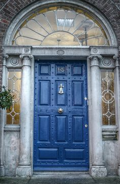 Doors of Dublin, painted different colors so people coming home from the bars could pick out their homes.....