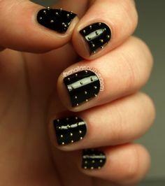 Black polish, gold studs. -CM