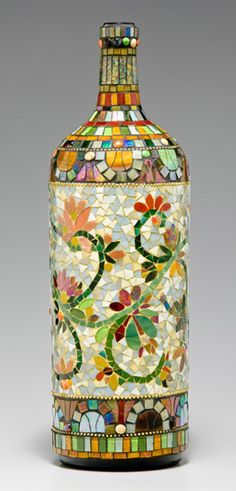"Vinery Finery glass mosaics Huge ""Nebakeneezar"" wine bottle, mosaic-ed with hand cut glass and smalti mosaic and brass BB's by Nancy Keating. Mosaic Bottles, Mosaic Glass, Glass Art, Stained Glass, Cut Glass, Mirror Glass, Mosaic Madness, Wine Bottle Art, Wine Bottle Crafts"