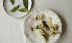 These small fritters make a great bar snack alongside a cold drink. Alternatively, they can be used with various vegetables, such as courgette and aubergines (or fish), as part of a fritto misto. Whole capers, deep-fried, can be scattered over the final dish.  Makes 20 150g plain flour, sifted 2 tbsp olive oil 2 egg whites 1 tbsp finely grated parmesan 10 anchovy fillets (in olive oil) 40 sage leaves