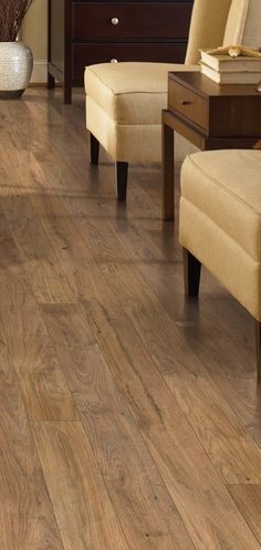 The defined graining and unique markings of this laminate floor give it an authentic rustic oak look.