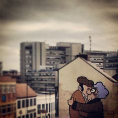Street art by local legend Pete McKee on the exterior wall of Fagan's pub, Sheffield. I took this photo after stumbling across it by complete chance on Saturday morning. I love the street art in my. Sheffield Pubs, Sheffield Art, Sheffield Steel, Pete Mckee, Local Legends, Reasons To Smile, England Uk, Art And Architecture, Urban Art