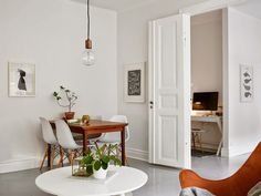 A Swedish apartment with a cosy bed and glossy grey floor (via Bloglovin.com )