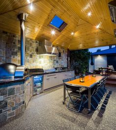 outside kitchen design stove small fridge dining area table chairs ceiling lights cabinet contemporary style of Marvellous Outside Kitchen Designs to Get Kitchen Design Ideas From