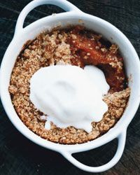 """Peach Crisps - """"I think Missouri food seems to have stronger ties to the cooking of the South than the upper Midwest,"""" Paul Virant says. (Amen!) Here, he bakes his simple peach crisps—a classic Southern dessert—in individual ramekins, but the sweet summer fruit and crunchy, buttery topping could be prepared in a single baking dish as well."""