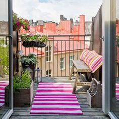 A beautifully styled balcony with quite the view. (via plentyofcolour)