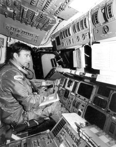 Space Shuttle STS-1 - Astronaut John Young conducting a pre-flight check on Space Shuttle Columbia (October 1, 1980).