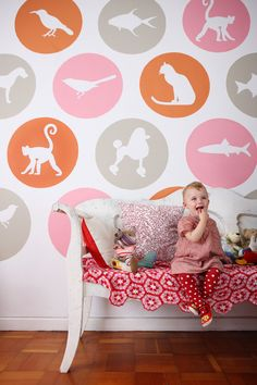 Fun, funky nursery using animal stencils. (You can download these stencils for free by clicking the attribution link.)