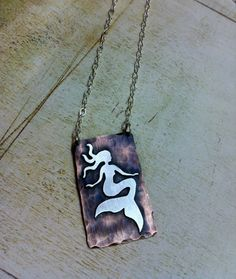 Hi necklace.  I want to own you.  Mixed Metal Jewelry Floating Copper Mermaid Silver and by Arrok
