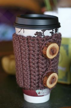 i would pay someone to make me one like this an one for a mug with a handle. pretty please? maybe in burgundy?The Sitting Tree: Free Knitting or Crochet Pattern Tutorial: Coffee Cozy