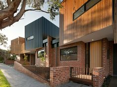 green sheep collective alphington townhouses timber cladding timber and steel fences recycled red brick. Architecture Durable, Architecture Design, Modern Residential Architecture, Plans Architecture, Education Architecture, Sustainable Architecture, Architecture Awards, Japanese Architecture, Perspective Architecture