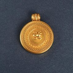 """An antique Carlos Giuliano 14K yellow gold locket featuring a gold frog. The locket opens up and the inside can be removed to add a picture. The locket is signed """"C.G."""" on the back."""