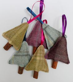 Sweet little tweed Christmas Tree decorations stuffed with cloves (and wadding for shape) and finished with a cinnamon stick trunk. Available in purple, lime green or pale blue tweed, they give off a beautiful Christmas aroma and make a lovely pre-Christmas gift, holiday decoration or stocking stuffer.  The tweed trees are 8cm (3 1/4) wide at the tweed base and 11cm (4.5) high from the top of the tree to the base of the trunk. The ribbon loop is approximately 7cm (3) long.  Please add a...