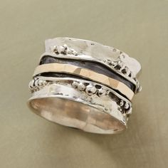 """WITH THE TIDES RING -- Bubbles lap at our hand-hammered silver & gold ring's sterling silver shorelines; a 14kt gold overlay band swirls within the channel. Exclusive. Whole sizes 5 to 9. 1/2""""W."""