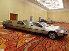 This DeLorean stretch limo with three full sets of gull wing doors was created by Rich Weissensel. It began as a sketch and an order for a custom stainless steel frame after meeting John DeLorean at the DeLorean Car Show in 2000, and took the following 12 years to complete. Rich had hoped to give John a ride in his creation, but it was nowhere near completion when DeLorean died in March of 2005.