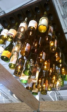 Amazing wine bottle light fixture that hangs in the We Olive & Wine Bar at The OC Mart MIX