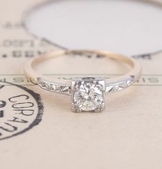 1940's .40ct Solitaire with Scrolling Shoulders - not so keen on the band but otherwise love it