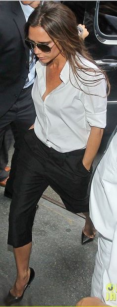 Victoria Beckham: Shirt, sunglasses, and pants – Victoria Beckham collection Shoes – Manolo Blahnik
