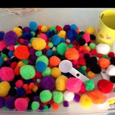 Pom Pom sensory box  Add 100 pom poms with spoons, tongs, cups and bowls.  For added learning, number the cups or bowls and encourage the children to place that many pom poms in each!